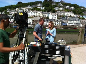 James Tanner preparing to cook Looe harbour-side