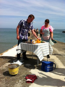 James Tanner preparing to cook on the pier at Looe