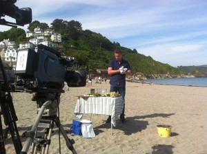 James Tanner preparing to cook on the beach at Looe